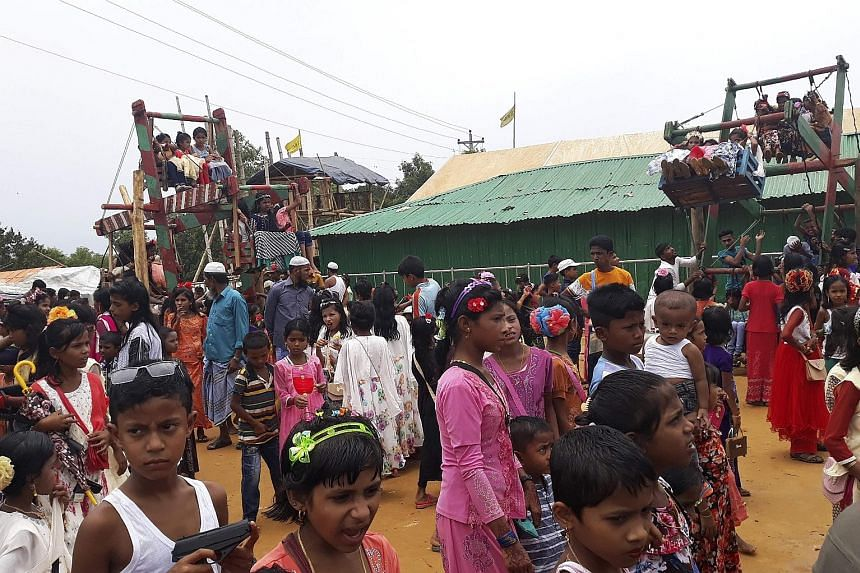 Rohingya refugees celebrating the Eid Al-Fitr festival last Wednesday at a camp near Cox's Bazar in Bangladesh. The leaked report gives a glowing assessment of Myanmar's efforts to entice the refugees back from Bangladesh, where some 740,000 have tak