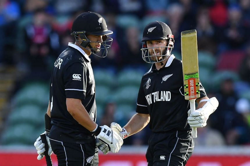 Kane Williamson (right) celebrates with Ross Taylor on reachng his half century.