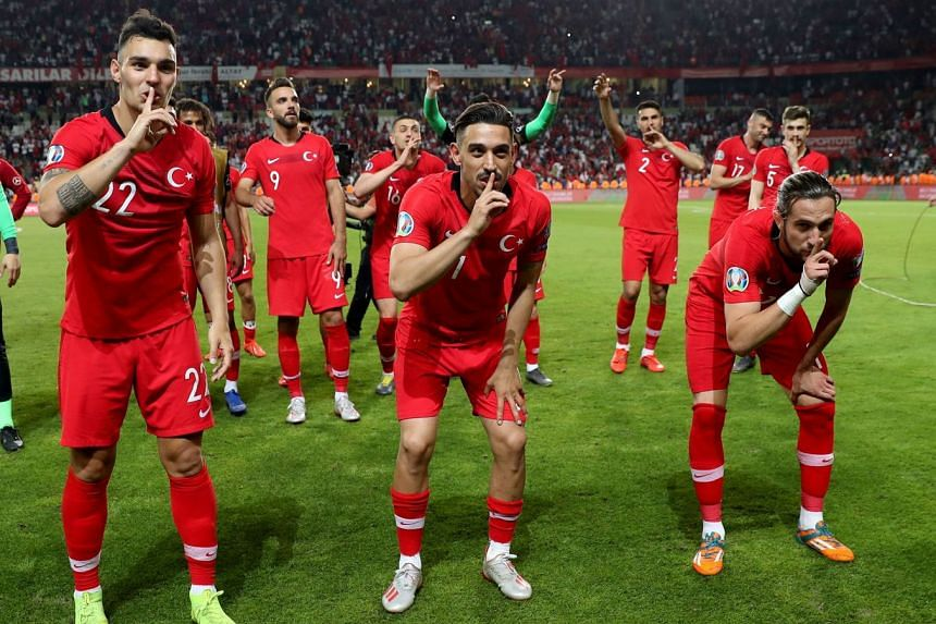 Turkey players Kaan Ayhan, Irfan Kahveci and Yazici Yusuf celebrates at the end of the match.