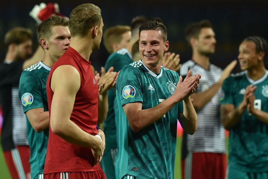Germany's players thank supporters after the match.
