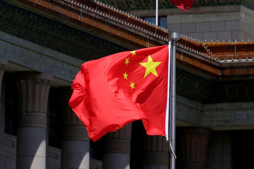 A Chinese flag flutters in front of the Great Hall of the People in Beijing, China, on May 27, 2019.
