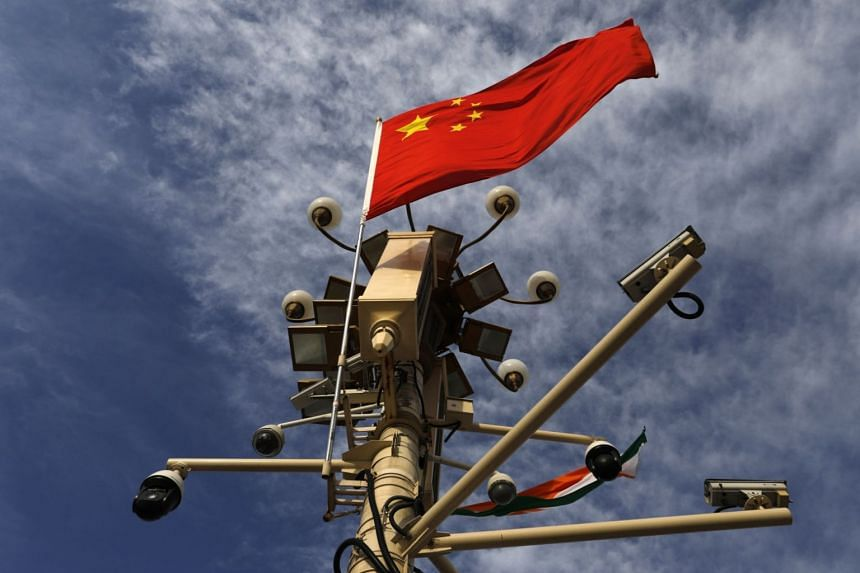 The Chinese national flag and surveillance cameras seen on Tiananmen Square in Beijing, China, on May 30, 2019.