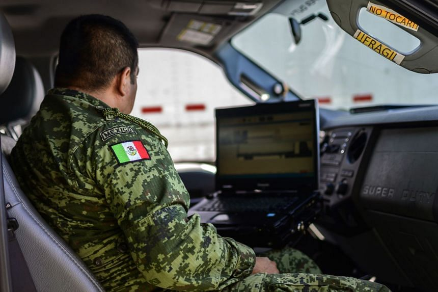 A Mexican soldier checks a gamma-ray device at a checkpoint on the outskirts of Tapachula, Mexico.