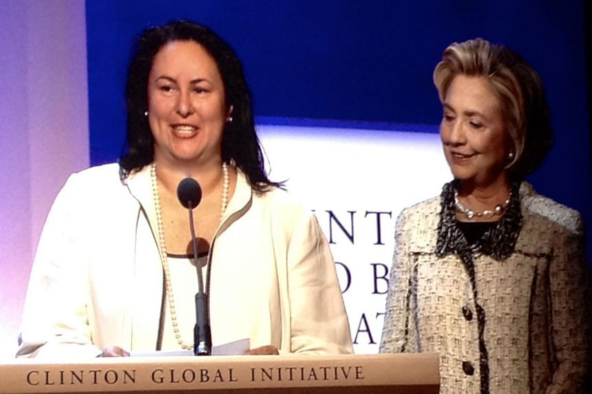 Ms Elizabeth Vazquez, seen here in 2013 with Mrs Hillary Clinton, is an adviser to the Clinton Global Initiative, which seeks solutions to global problems. Ms Elizabeth Vazquez is co-founder and chief executive of WEConnect International, the only co