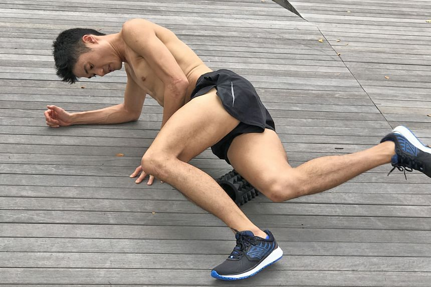 Singapore's former triathlon and marathon SEA Games gold medallist Mok Ying Ren uses a foam roller to reduce muscle tightness and increase blood circulation.