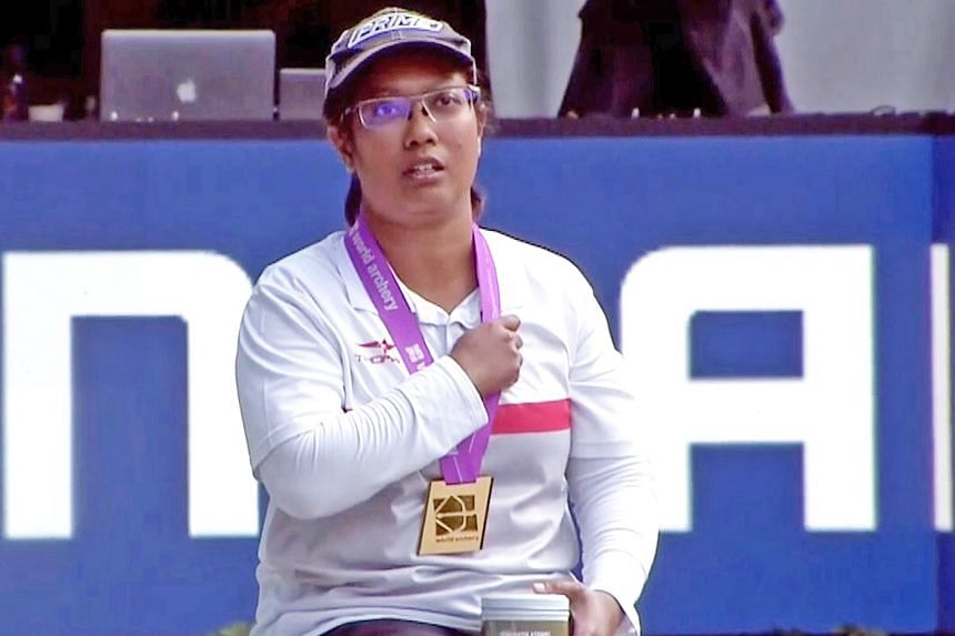 Nur Syahidah Alim singing the national anthem after receiving the gold medal in this video screengrab. The 33-year-old beat Paralympic champion Jessica Stretton of Britain in a shoot-off for the compound gold at the World Archery Para Championships i