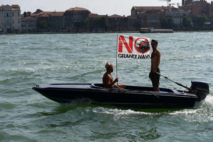 "Protesters fly a banner that reads, ""No Grande Navi"" (No big ships) during the demonstration."