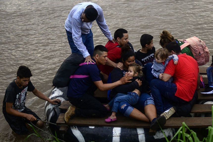 Migrants and residents use a makeshift raft to illegally cross from Guatemala to Mexico.