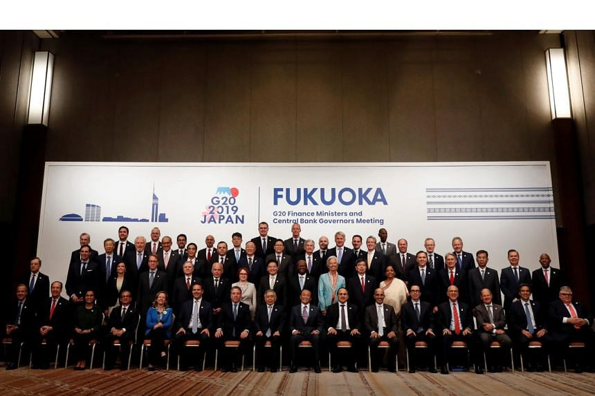 Delegates to the G-20 Finance Ministers and Central Bank Governors meeting posing for a photo in Fukuoka, Japan, on June 9, 2019.