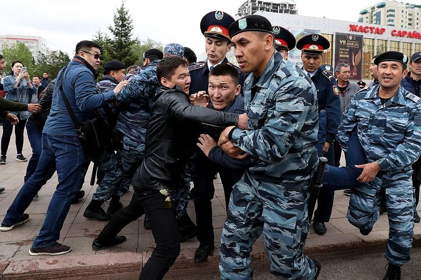 Opposition supporters clashing with police yesterday at a protest during the presidential election in Nur-Sultan, Kazakhstan. PHOTO: EPA-EFE