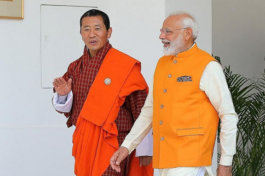 Indian Prime Minister Narendra Modi (right) and Bhutan Prime Minister Lotay Tshering heading for a Bimstec meeting in New Delhi on May 31.