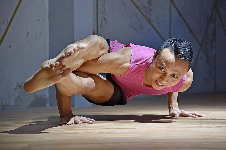 Yoga instructor Derris Chew doing an eight-angle pose.