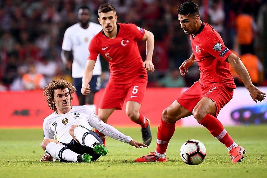 France forward Antoine Griezmann is easily shackled by Turkey defender Zeki Celik during their Euro 2020 qualifier in Konya. The hosts beat the world champions 2-0 to lead Group H by three points.