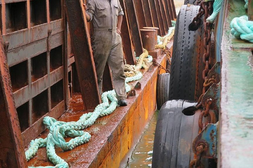 Left: Out at sea unsupervised, a tugboat crew can overwrite a vessel's operation duration in the logbook to increase the oil consumption per day, making up for the shortfall in fuel after the illegal sale. Below: Insiders say the high profitability o