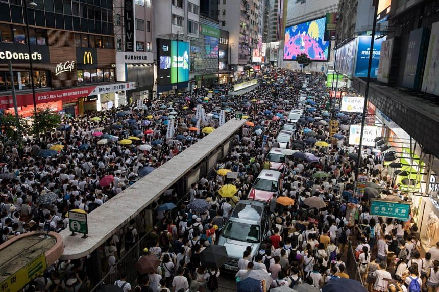 Thousands of protesters take part in a march against amendments to an extradition Bill in Hong Kong, on June 9, 2019.
