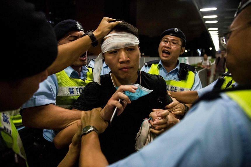 A protester is arrested after a rally against a controversial extradition law proposal in Hong Kong on June 10, 2019.