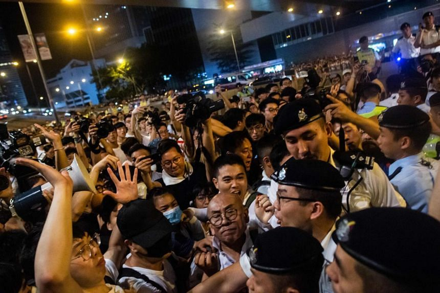 Agitations are seen between pro-independence supporters and protest organisers during a rally against a controversial extradition law proposal in Hong Kong on June 9, 2019.