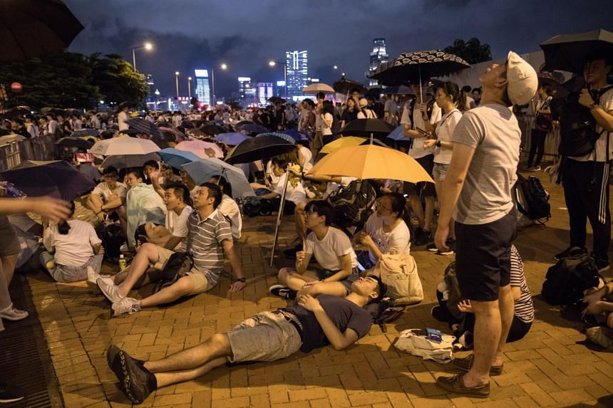 Protesters outside the Legislative Council during a march against a controversial extradition law proposal in Hong Kong on June 9, 2019.