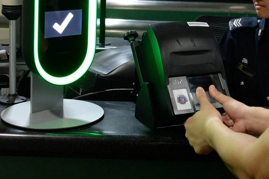 Biometric screening system in use at Woodlands Checkpoint.