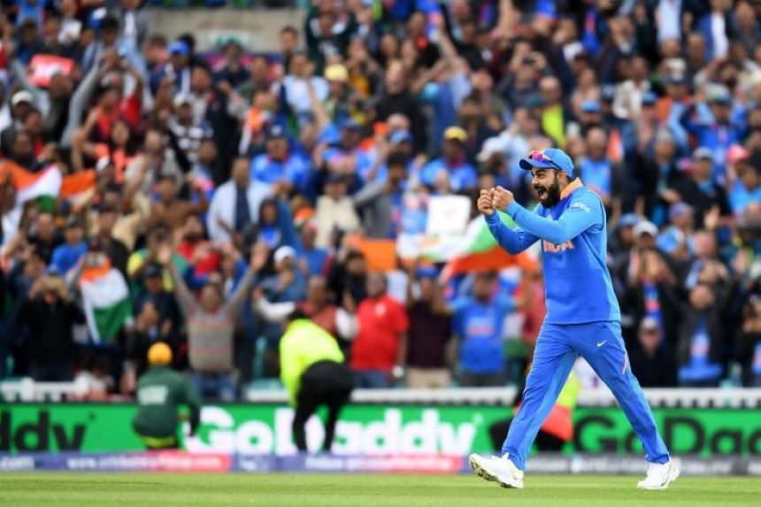 India's captain Virat Kohli celebrates after victory in the 2019 Cricket World Cup group stage match between India and Australia at The Oval in London on June 9, 2019.