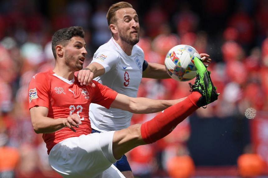 Switzerland's Fabian Schar (left) in action against England player Harry Kane during the Uefa Nations League third place soccer match between England and Switzerland at D. Afonso Henriques stadium in Guimaraes, Portugal, on June 9, 2019.