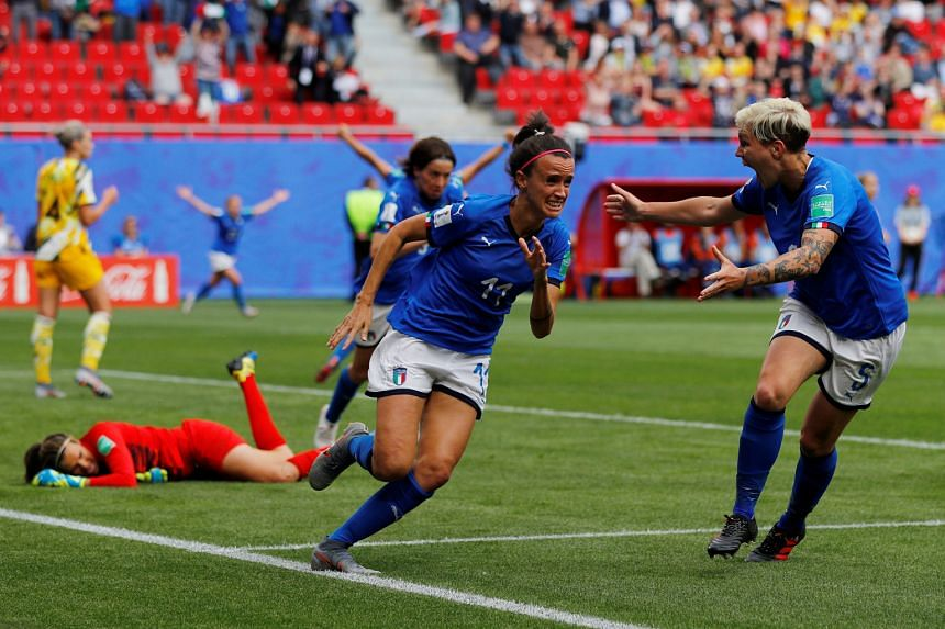 Italy's Barbara Bonansea sprinting away in celebration after scoring her second goal, a last-gasp winner against Australia yesterday.