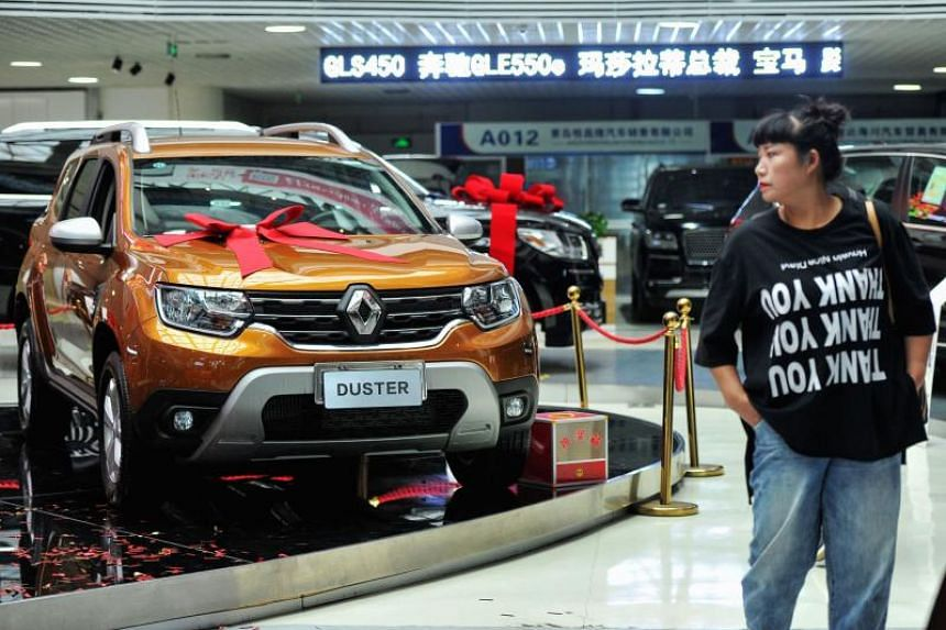 A customer looks at an imported Renault car in a showroom in China's eastern Shandong province.