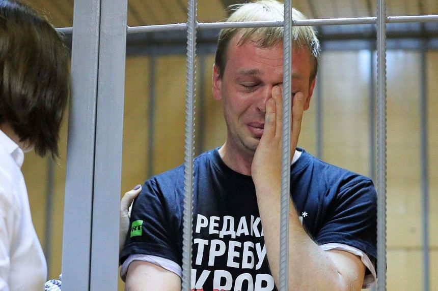A lawyer comforts Russian investigative journalist Ivan Golunov during a court hearing in Moscow.