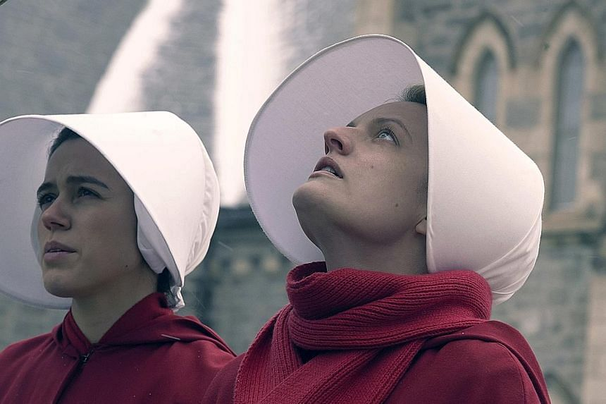 Elisabeth Moss (right) reprises her role as June in the third season of The Handmaid's Tale.