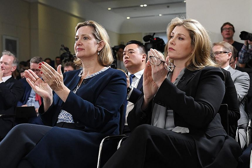 Britain's Work and Pensions Minister Amber Rudd (left) and Defence Minister Penny Mordaunt at the launch of Foreign Minister Jeremy Hunt's campaign to become the leader of the Conservative Party, in London yesterday.
