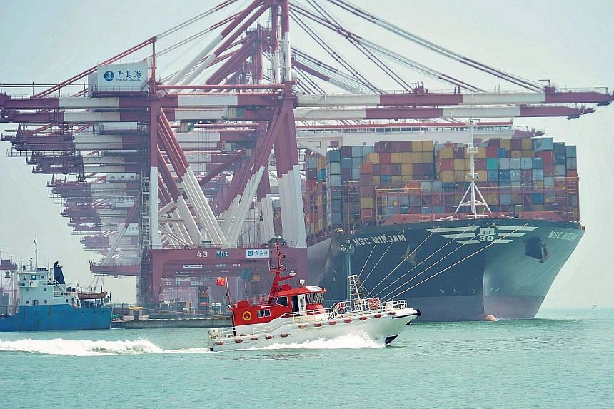 A container ship at Qingdao port in Shandong province. Some analysts suspect Chinese exporters may have rushed out shipments to the United States last month to avoid new tariffs that the US is threatening to impose in its trade dispute with China. PH