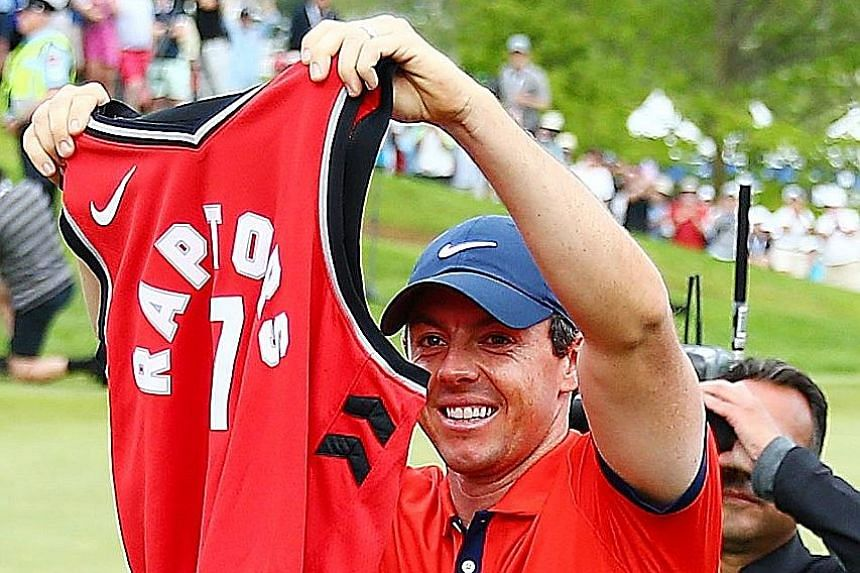 Rory McIlroy with a Toronto Raptors jersey after winning the Canadian Open in Ontario on Sunday. The Raptors need one win to clinch their first NBA title.