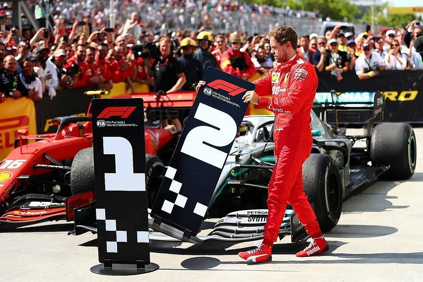 Ferrari's Sebastian Vettel taking it upon himself to swop the number boards for the finished cars at the parc ferme of the Circuit Gilles Villeneuve. The German crossed the finishing line at the Canadian Grand Prix first, but a time penalty meant he