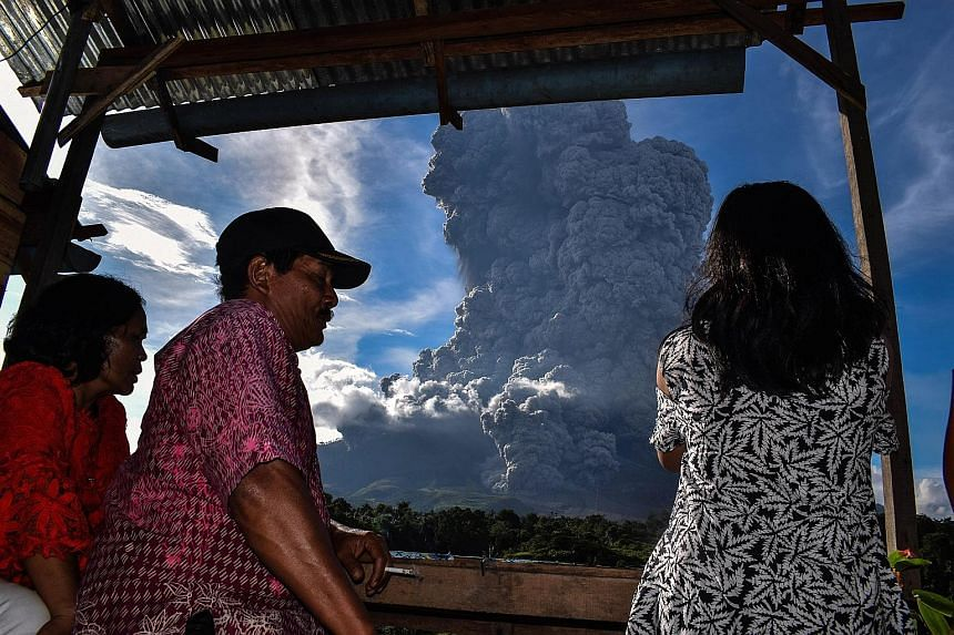 Indonesian officials yesterday warned of possible further eruptions from an active volcano in Sumatra after it emitted a huge column of ash, causing panic among residents. Mount Sinabung, which has seen a spike in activity since 2010, erupted for aro