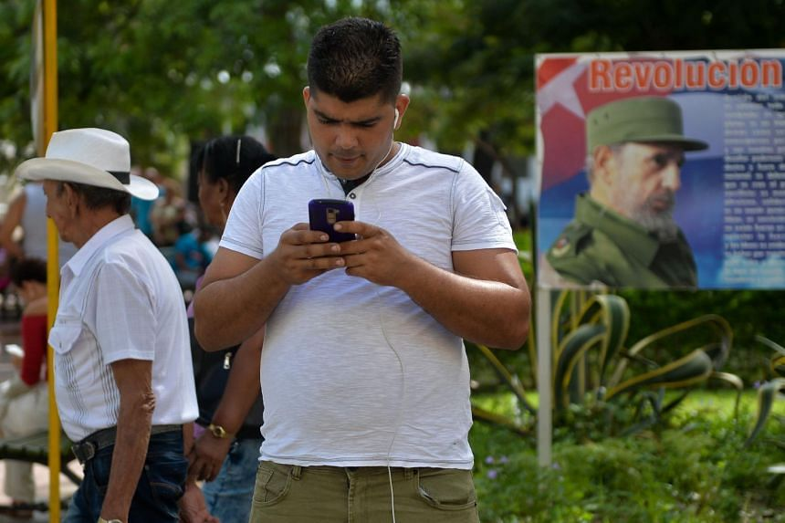 A man looking at his mobile phone in Havana, Cuba, on March 17, 2019.