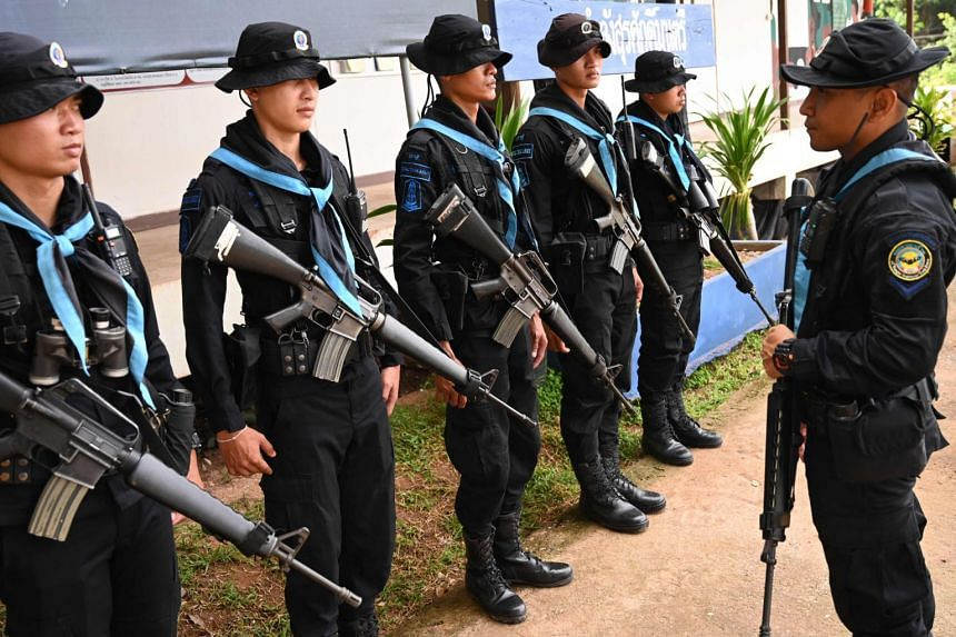 Thai military rangers preparing for a foot patrol along the Mekong river bordering Thailand and Laos in Ban Paeng, Nakhon Phanom province.