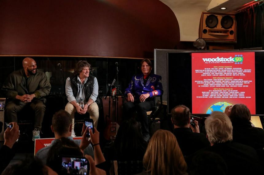 Rapper Common, Woodstock producer Michael Lang and singer John Fogerty, announcing the line-up for the Woodstock 50th Anniversary concert in New York, on March 19, 2019.
