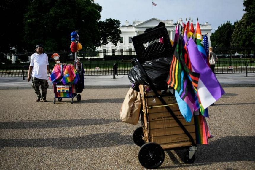 Vendors stop on Pennsylvania Avenue in front of the White House while walking to the DC Gay Pride Parade in Washington, DC on June 8, 2019.