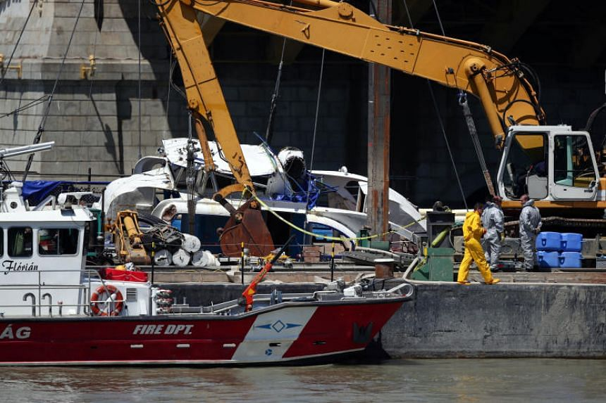 Members of a salvage crew work to raise The Mermaid, a Hungarian boat which sank in the Danube river, during a salvage operation in Budapest, Hungary, on June 11, 2019.