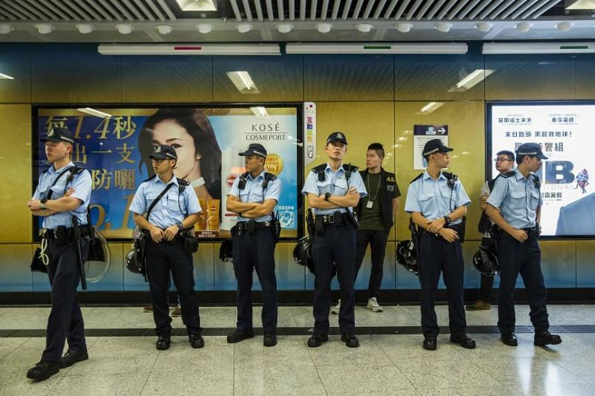 Police stand guard inside Admiralty MTR station in Hong Kong on June 11, 2019, two days after the city witnessed its largest street protest in at least 15 years.