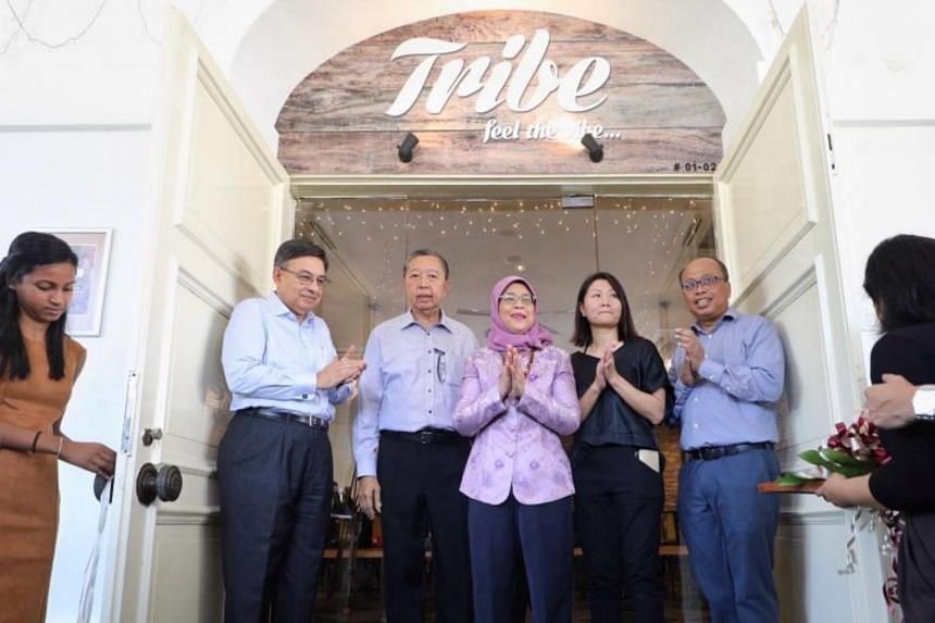 (From left) raiSE chairman Gautam Banerjee, PCSEA committee chairman Tan Soo Nan, President Halimah Yacob, Bliss Group founder Christine Low and raiSE CEO Alfie Othman at the official opening of Tribe by Bliss Group, which won the PCSEA Social Enterp
