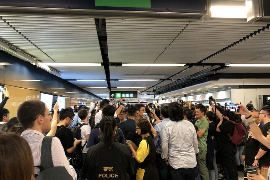 A media scrum in Admiralty station where a confrontation resulted from the police carrying out an extensive stop-and-search of passengers.