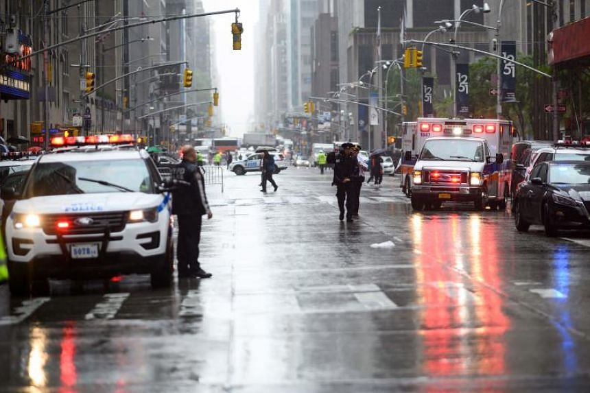 Emergency vehicles at the scene after a helicopter crashed atop a building and caused a fire in the Manhattan borough of New York on June 10, 2019.