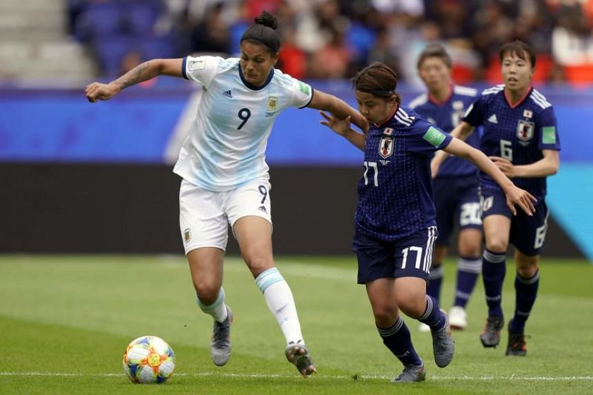 Argentina's forward Sole Jaimes and Japan's midfielder Narumi Miura vie for the ball during their France 2019 Women's World Cup Group D match at the Parc des Princes stadium in Paris on June 10, 2019.