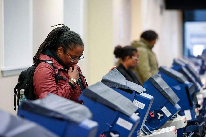 Voters casting their ballots at a polling place in downtown Chicago, Illinois, on April 2, 2019.