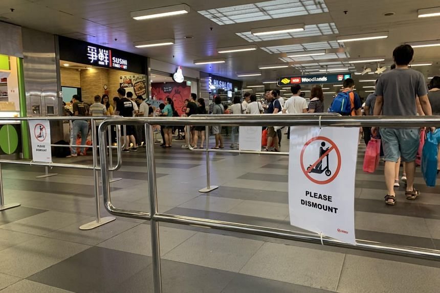 Metal barriers at Woodlands MRT station that have been put up in a bid to get users of PMDs to dismount while crossing the station concourse.