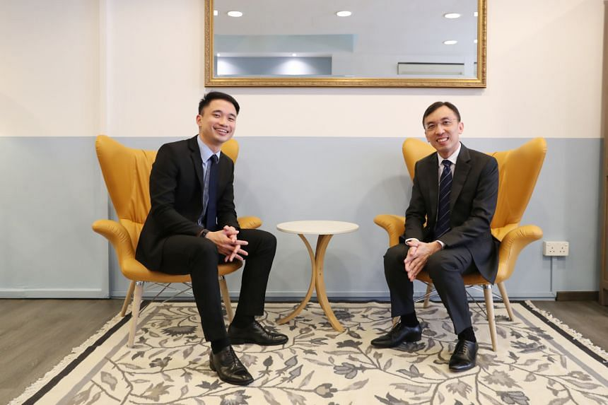Providend chief executive Christopher Tan (right) says flexi-work options help the firm retain talent such as client adviser Loh Yong Cheng (left), who works from home twice a month to look after his daughter.