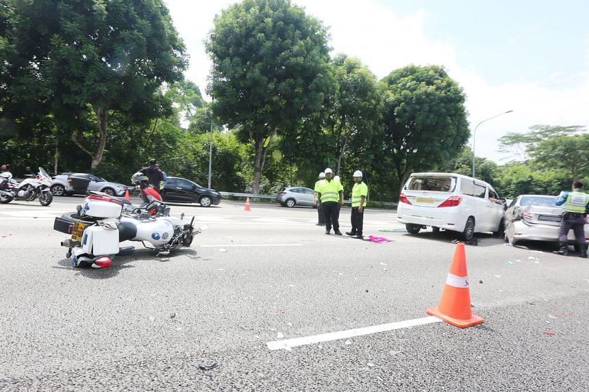 The site of the accident on Sunday, where a car skidded and hit a Traffic Police officer and an SCDF paramedic, who were attending to earlier accidents along the Pan-Island Expressway. PHOTO: SHIN MIN DAILY NEWS