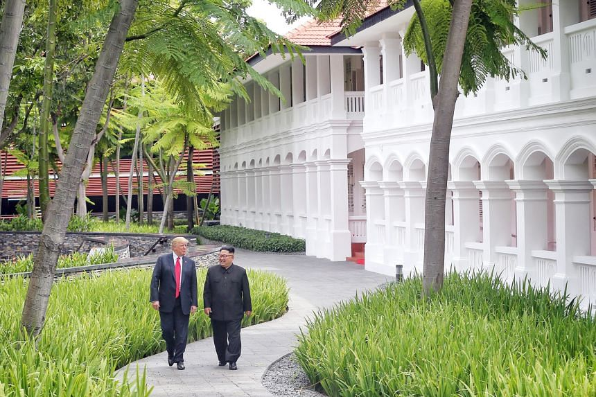 US President Donald Trump and North Korean leader Kim Jong Un at the Capella Hotel on Sentosa last year. A memorial plaque was to be unveiled today at the hotel, but the North Korean embassy has postponed the event.