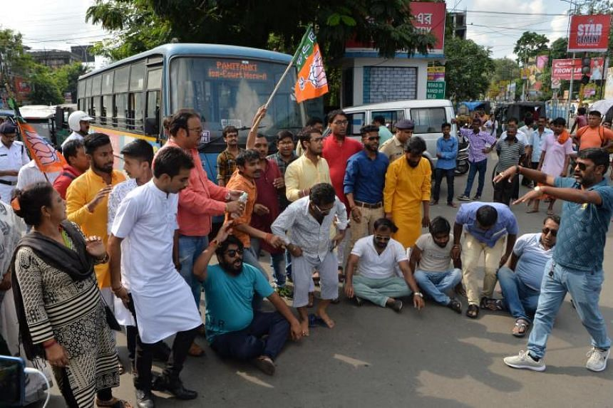 Supporters of the Bharatiya Janata Party shout slogans as they block a road during a protest against the recent killings at Sandeshkhali in West Bengal, India, on June 9, 2019.